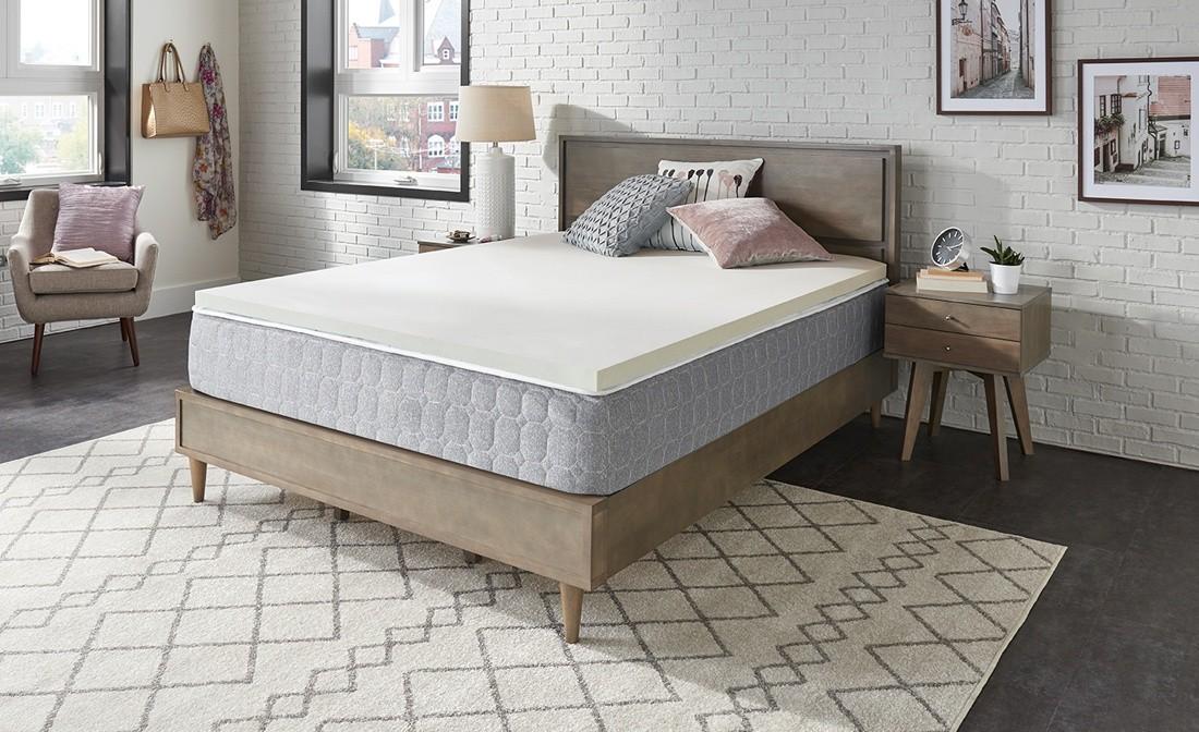 A two inch cream foam topper on a Sealy mattress